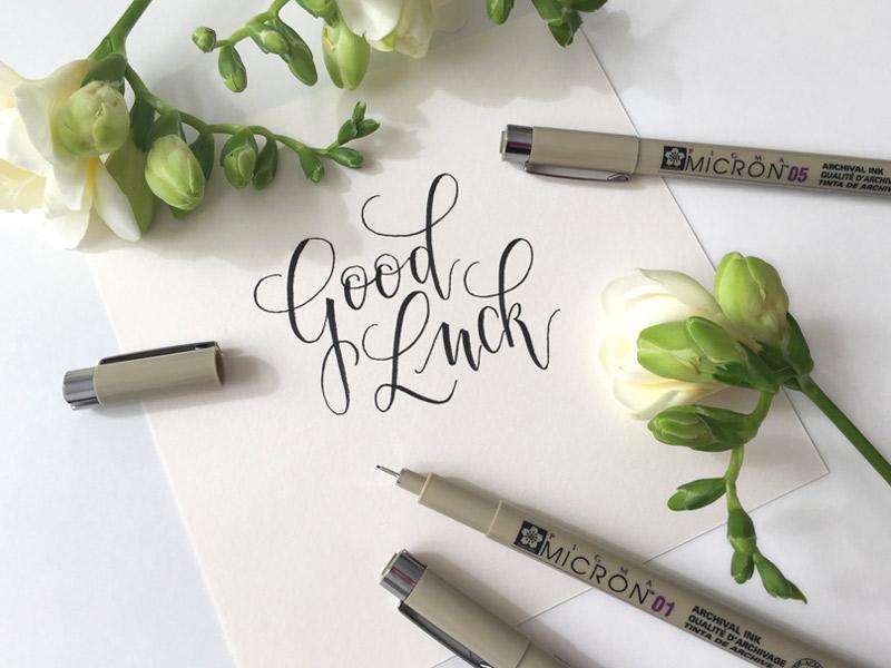 """""""Good Luck"""" in Kalligraphie geschrieben"""